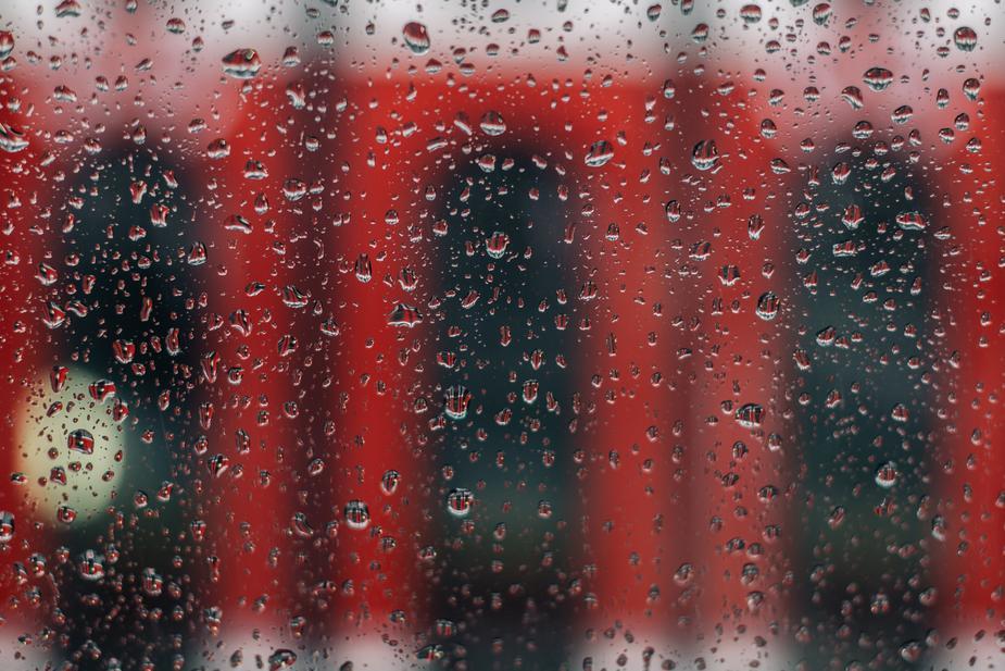 rainy-window-with-red-streetcar_925x.jpg