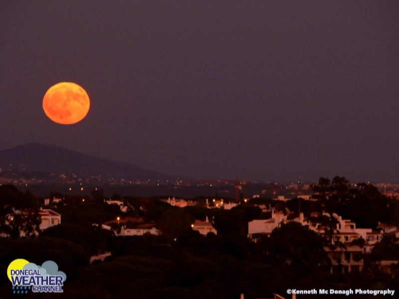 The October Full moon rise over   Albufeira Portugal captured by    Kenneth Mc Donagh Photography