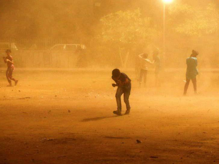 People trying to shelter from a dust storm in New Delhi over the weekend REUTERS