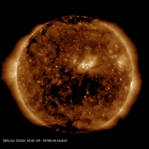 Solar wind flowing from the indicated coronal hole could reach Earth on May 17th. Credit: SDO/AIA