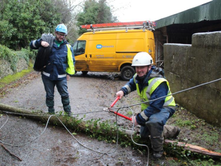 2c6eaad502d3f7ab33149067e6af87cd.jpg--storm_damage__esb_workers_sean_kelly__glin_and_declan_sheahan__broadford_at_work_on_a_fallen_pole_at_pallaskenry______picture__michael_cowhey.jpg