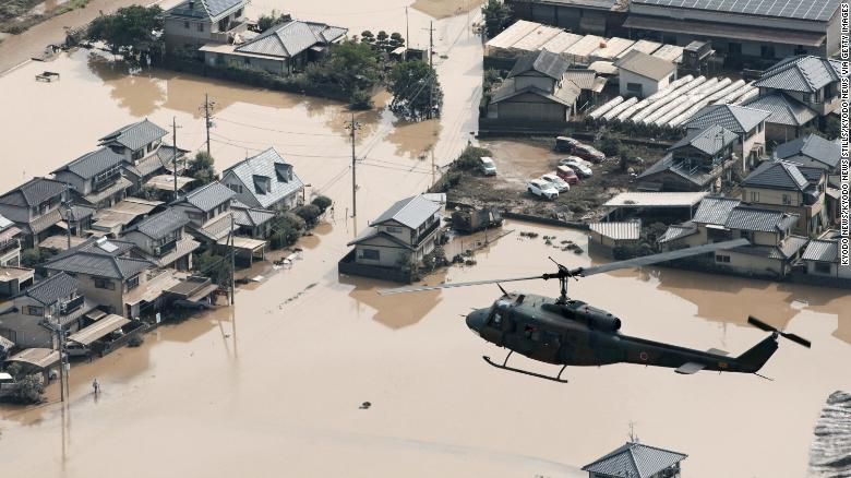 A residential area is seen on July 9 in Kurashiki, Okayama Prefecture, submerged following torrential rains that hit a wide area of western Japan.