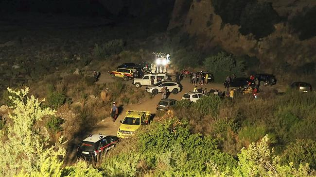 Rescuers are seen at the Raganello Gorge, a popular hiking spot in Civita, a village in the Italian Calabria southern region on August 20, 2018. (AFP)