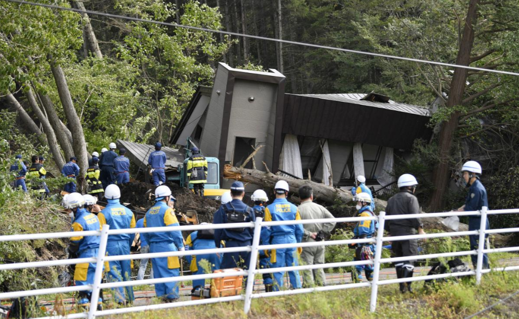 Police officers and rescue workers search for survivors from a building damaged by a landslide caused by a powerful earthquake in Atsuma town in Japan's northern island of Hokkaido, Japan, in this photo taken by Kyodo September 6, 2018. Mandatory credit Kyodo