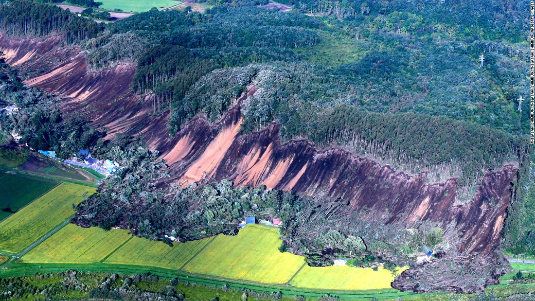 In this aerial image, houses are buried by multiple landslides after a powerful earthquake jolt on September 6, 2018 in Atsuma, Hokkaido, Japan.