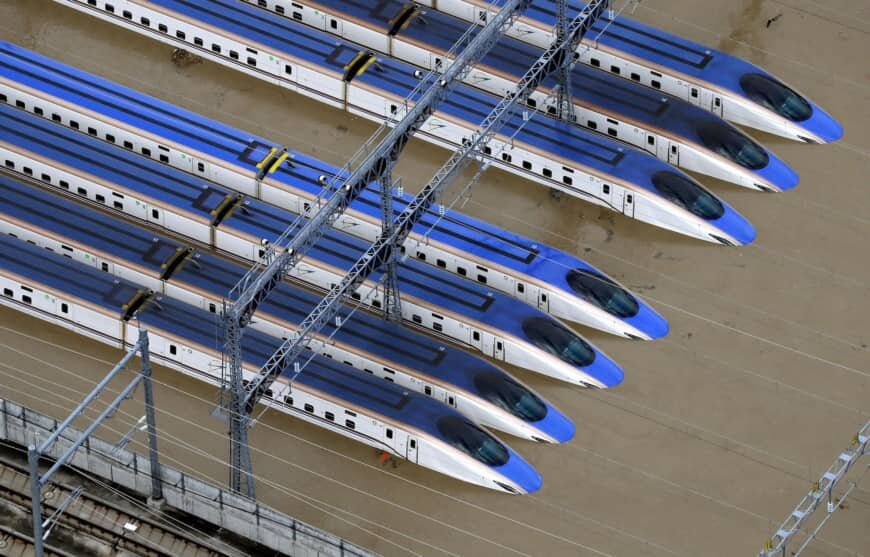 An aerial photo shows a shinkansen rail yard in Nagano partially submerged following flooding caused by Typhoon Hagibis. | KYODO