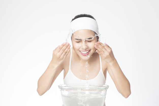 beautiful woman is washing her face white background 33799 2331