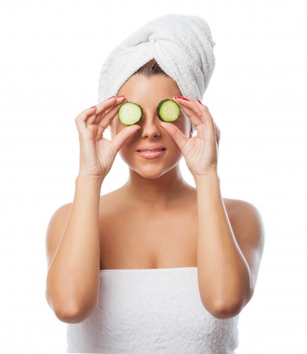 woman-holding-cucumber-slices-eyes_1187-5026.jpg