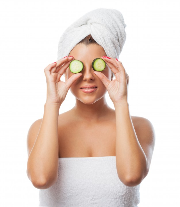 woman holding cucumber slices eyes 1187 5026
