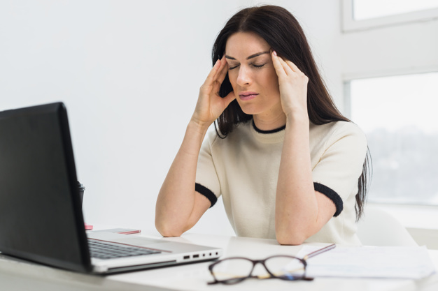 stressed woman sitting table with laptop 23 2148056161