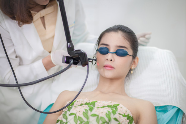 beautician giving laser