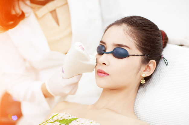 face care facial laser hair removal beautician giving laser epilation treatment young 38583 155