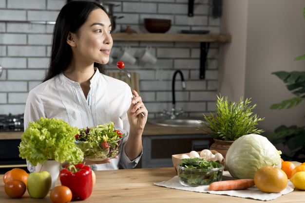 pretty young woman eating red cherry tomato holding bowl mixed salad 23 2148075984