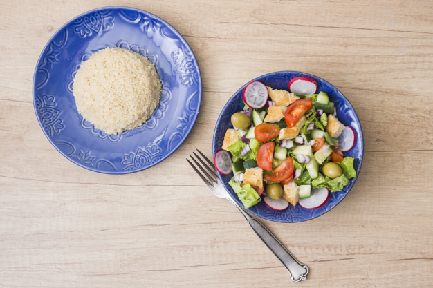 cooked-rice-with-vegetable-salad-wooden-table_23-2148080137.jpg