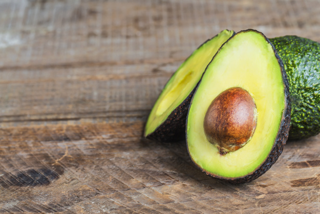 avocado on a dark wood background