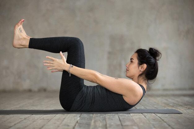 young woman doing navasana exercise 1163 5078