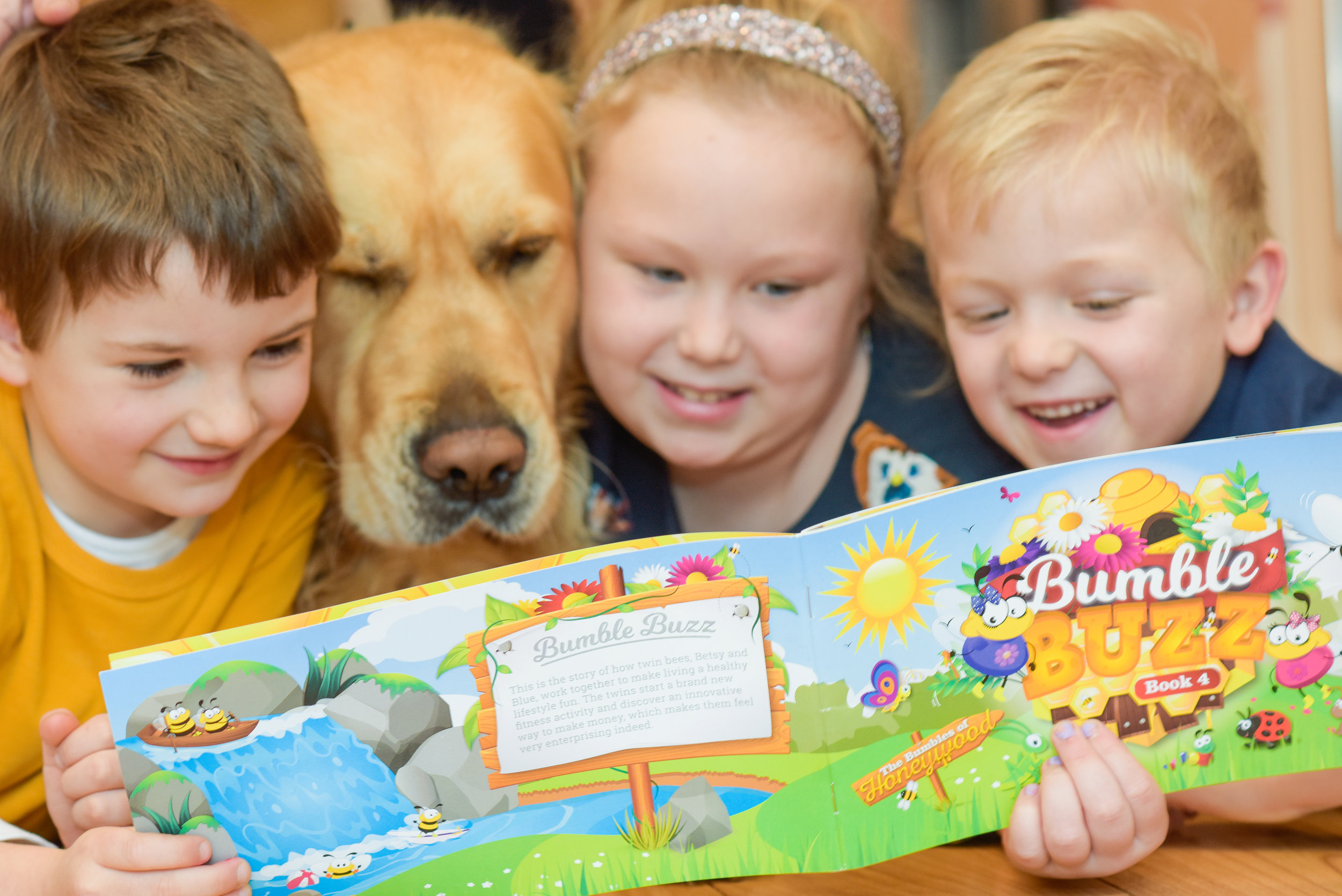 Sue's dog, Jack, can't resist getting in on the action while her grandchildren are reading the bumbles books