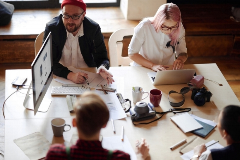 Creative Team Brainstorming In Office