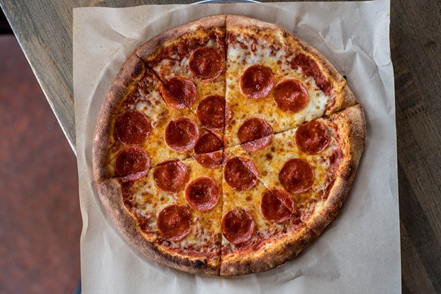 """Our Classic 12"""" round pizzas are perfect for piling on the fresh toppings! 💯  Grab one today to devour yourself or share -- they're the perfect size for passing around!"""