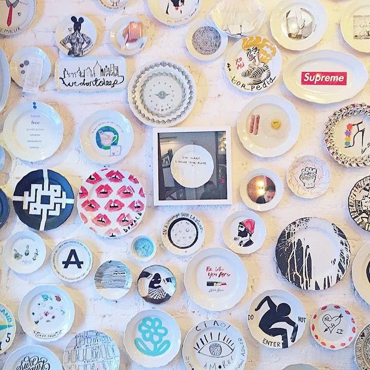 The wall of plates at Sant Ambroeus SoHo