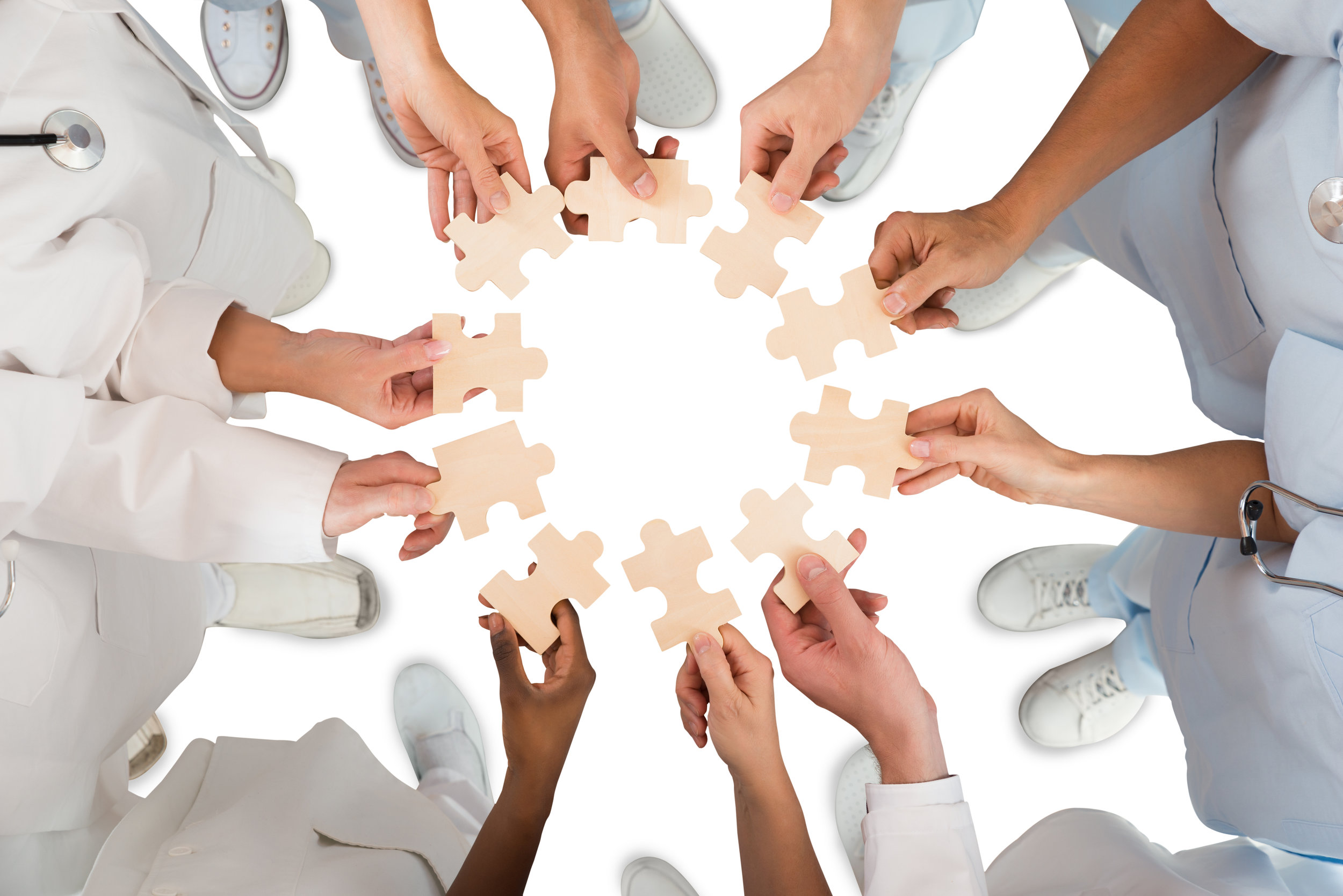 iStock-609686418-hands-puzzle.jpg