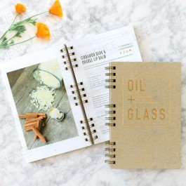 OIL & GLASS   The all-in-one resource for using essential oils.With its smart design and unique format, using essential oils has never been easier!OIL + GLASS is a beautiful and modern hard-cover recipe book, made with premium materials.