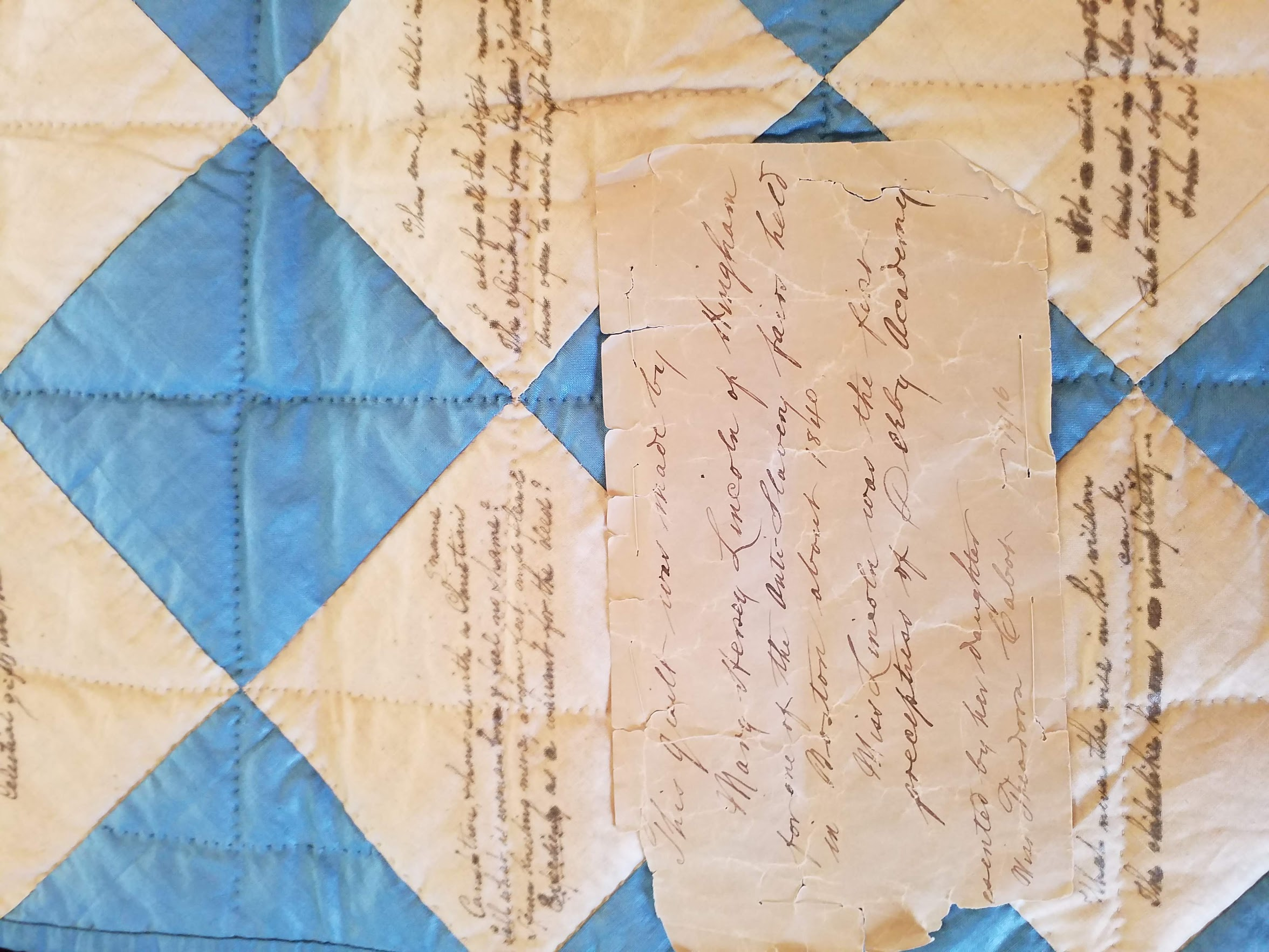 Label recording the quilt history and donation to the Hingham Historical Society