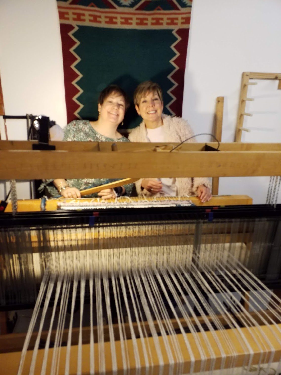 Having way too much fun with Renee Rucci of Renee Rucci Design. I am holding a shuttle to weave the weft threads through.