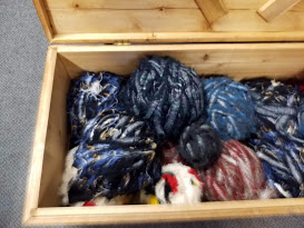 Box of salvage wool to choose from