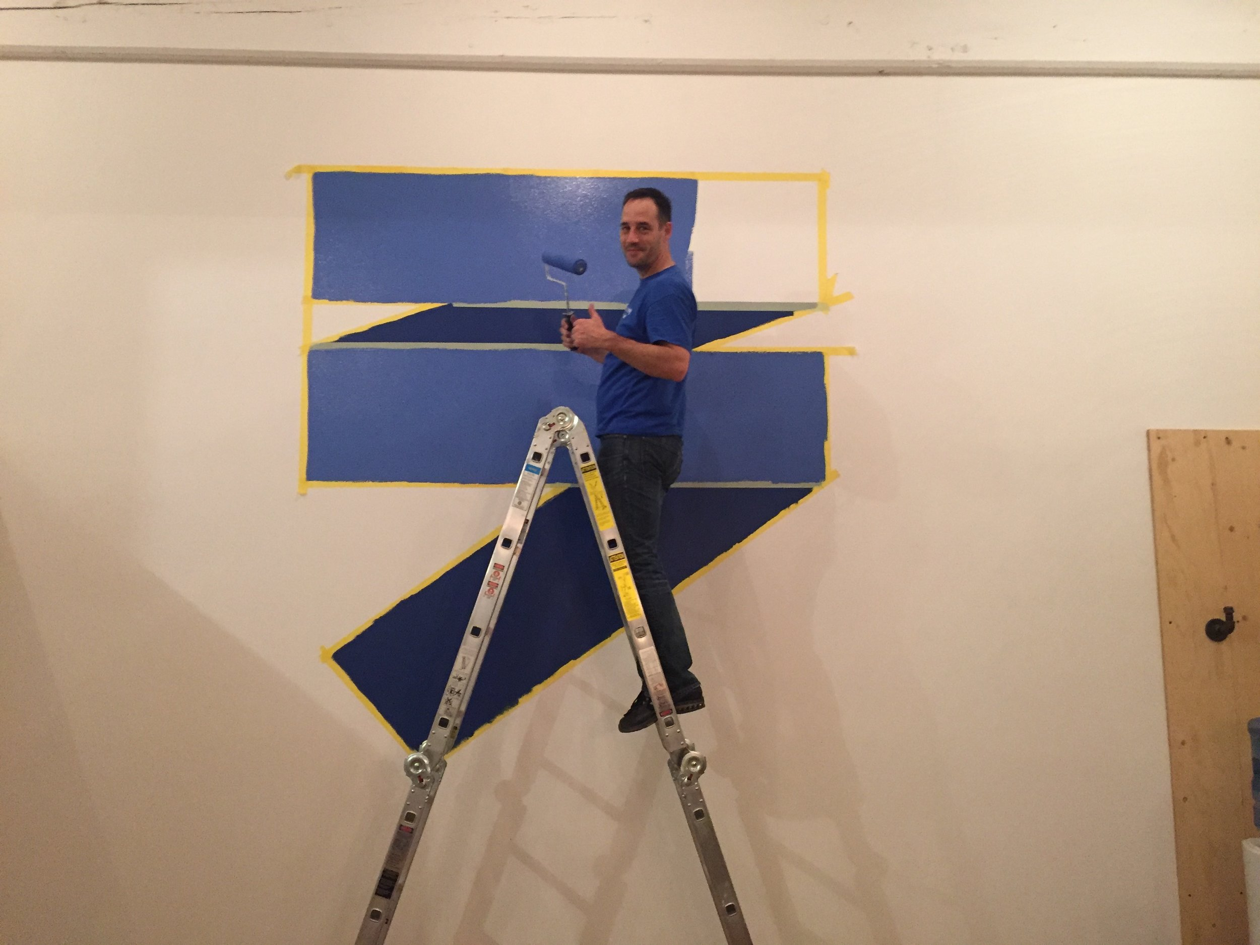 An important milestone in our story: the day we painted our logo on the wall