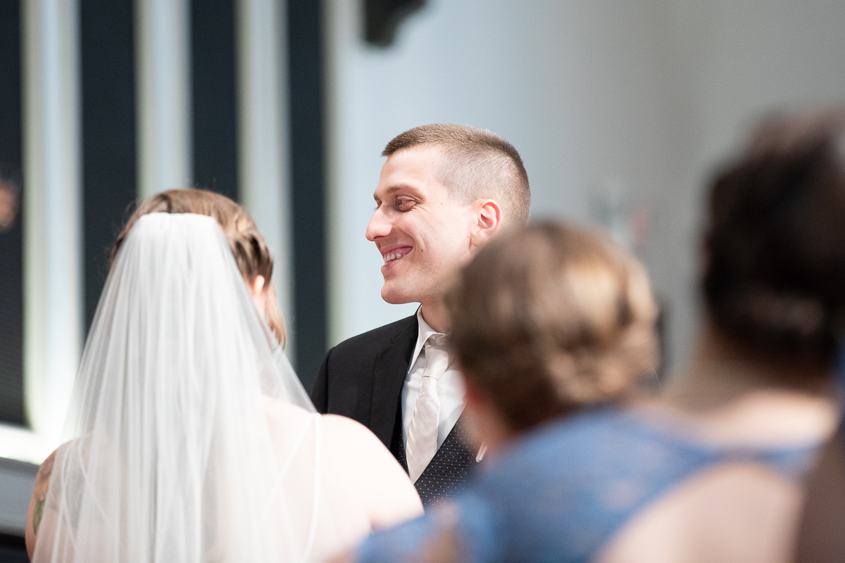 Groom during ceremony.