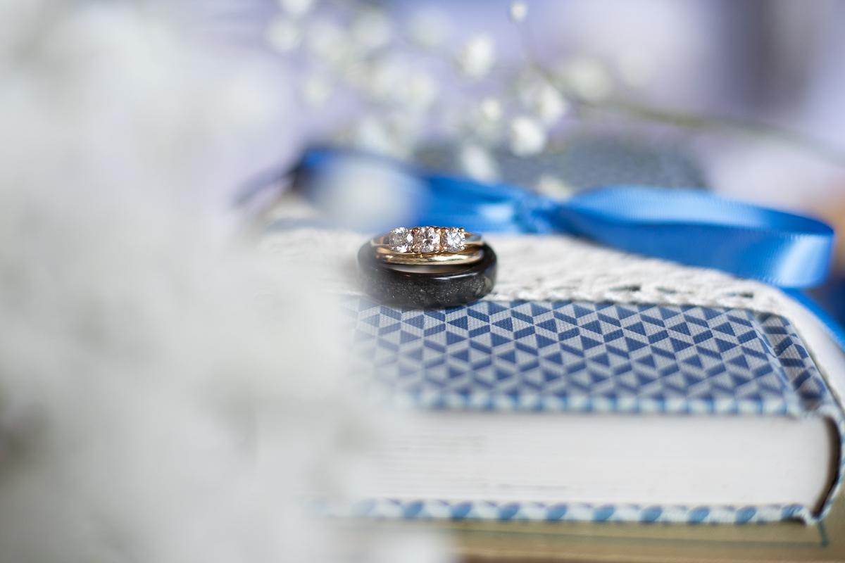 Wedding rings on books.
