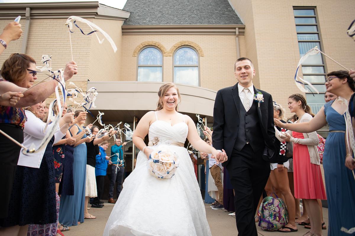 Bride and groom leaving reception.