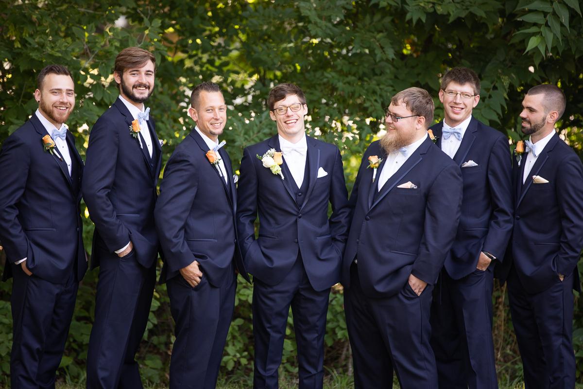 Groom and groomsmen laughing.