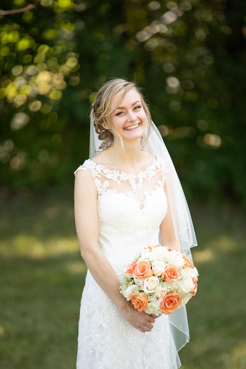 Bride smiling during bridal formal photos.
