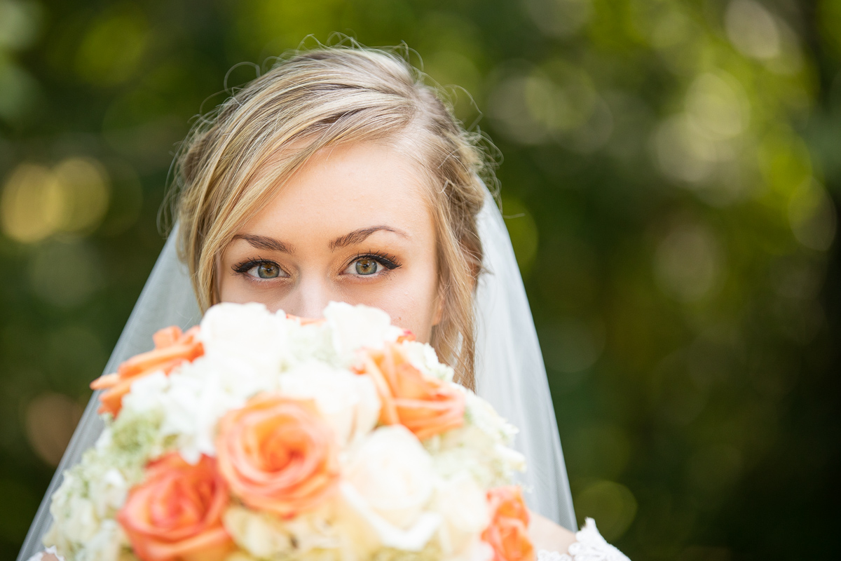 Bride holding bouquet during bridal formal photos.