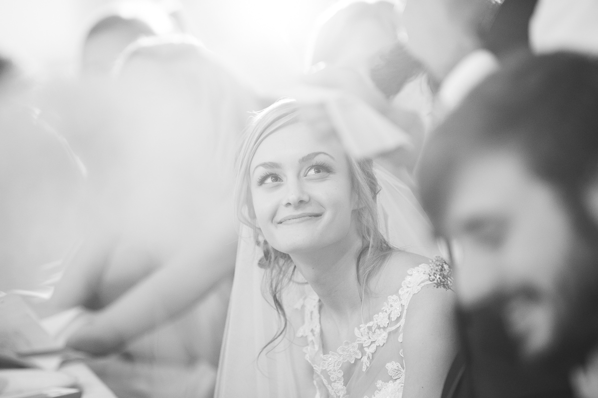 Bride during toasts at wedding reception.