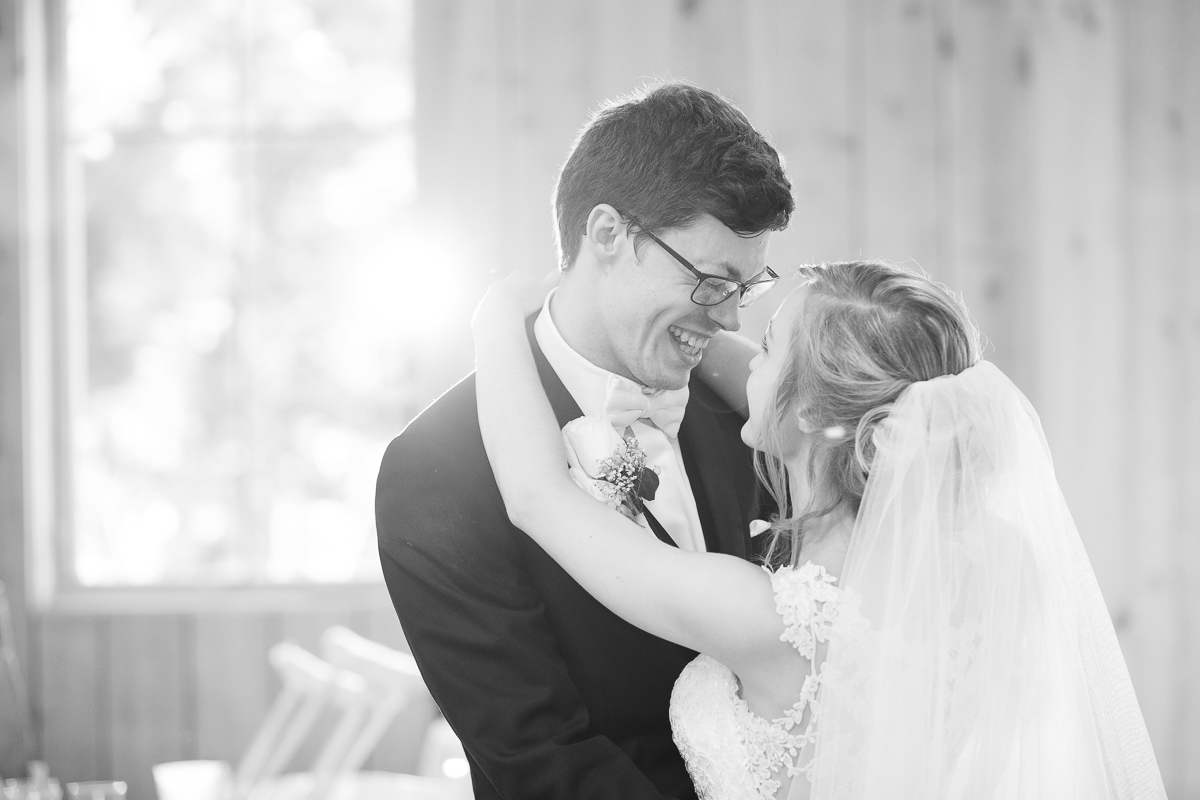 Black and white photo of bride and groom's first dance.