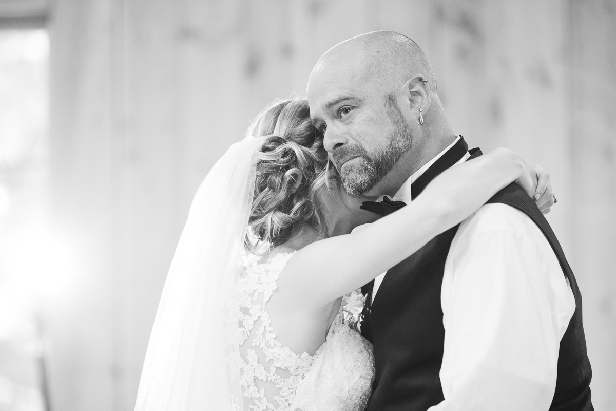 Black and white photo of father daughter dance.