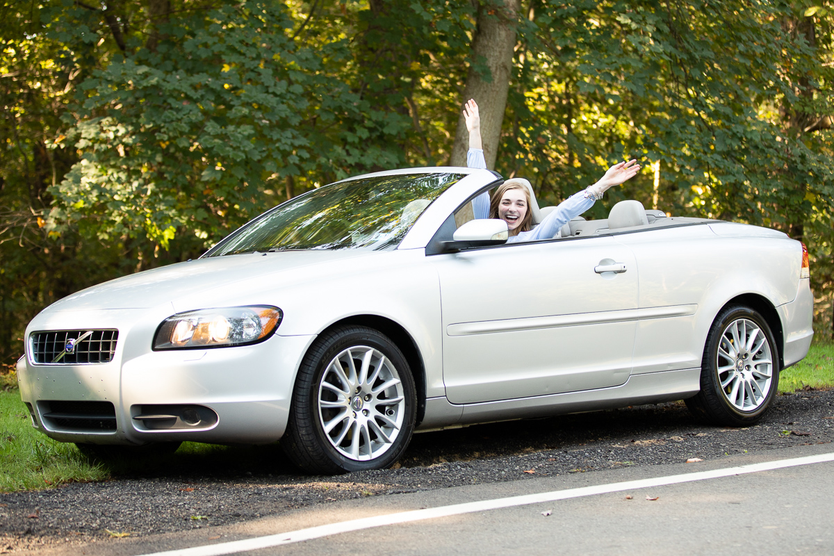 Senior pictures with convertible at Hartwood Acres Mansion