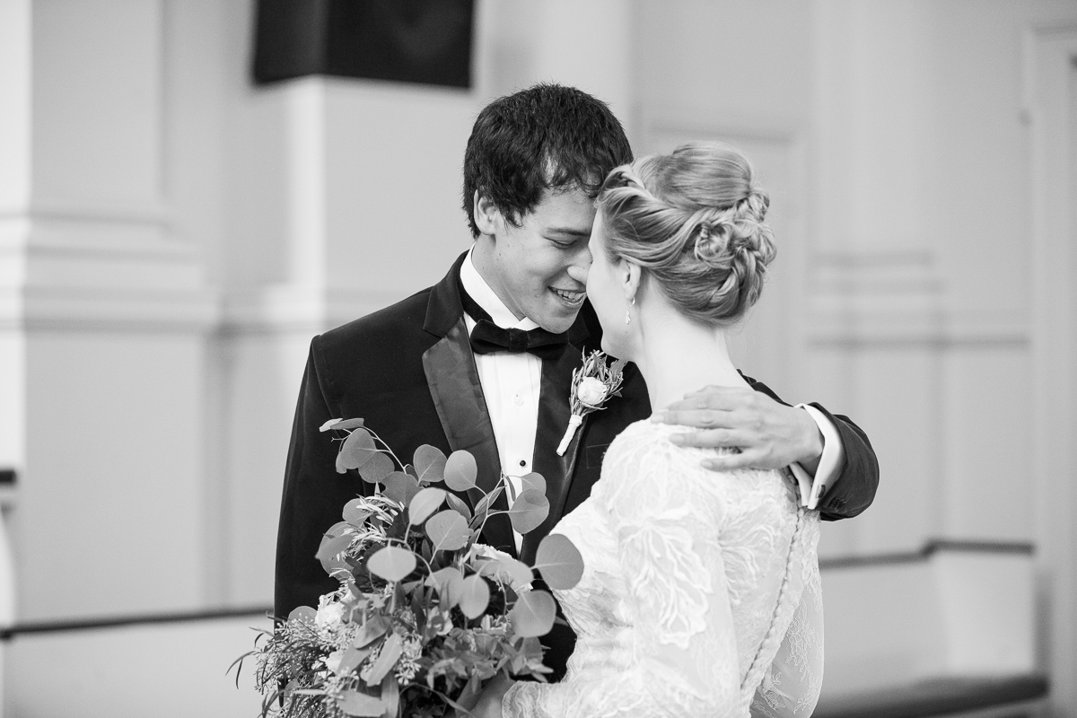 Black and white photo of bride and groom's first look.