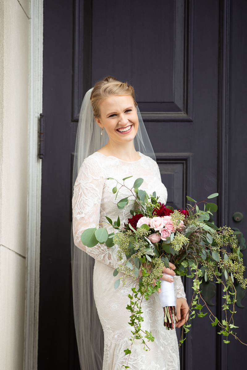 Bride laughing with bouquet at Boston wedding.