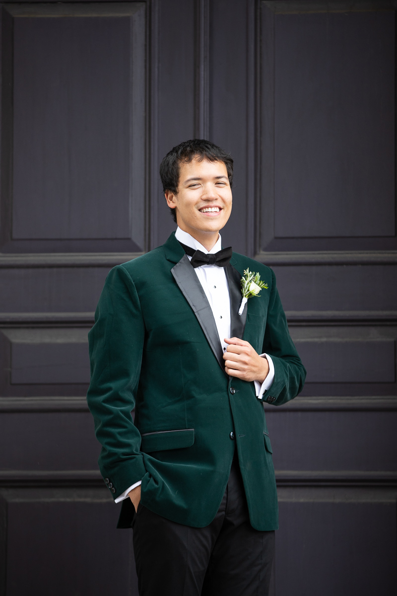 Groom laughing during formals at Boston wedding.