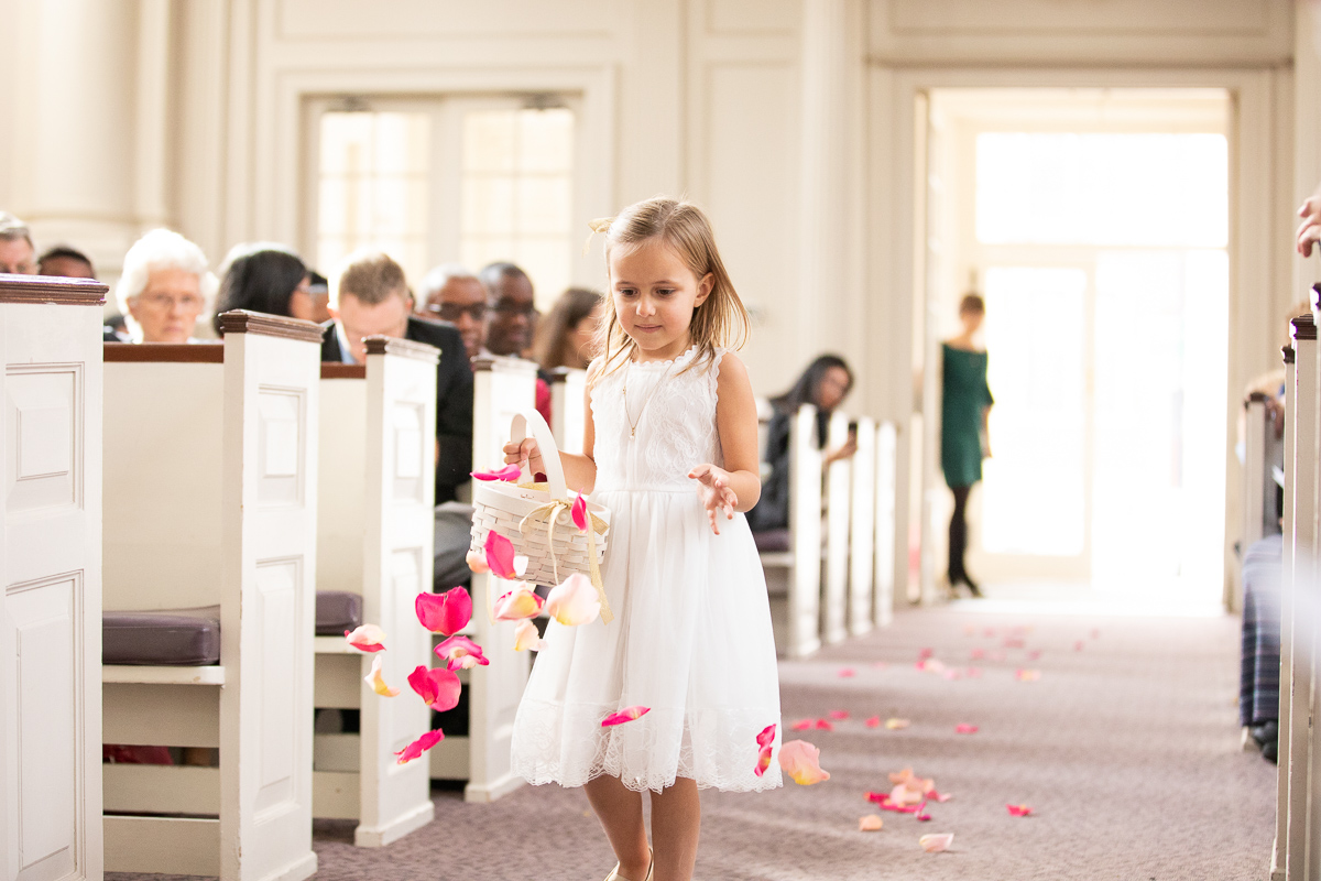 Flower girl throwing petals down the aisle.