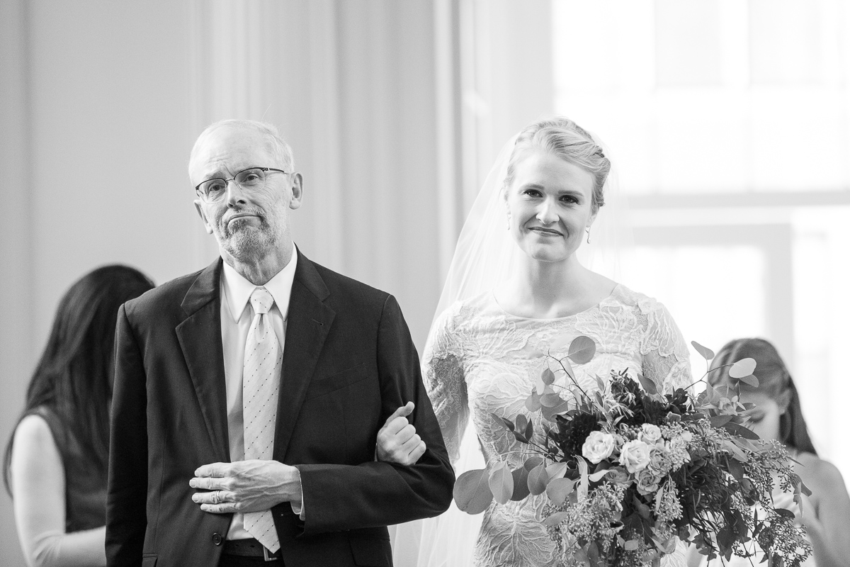 Bride walking down the aisle with her dad.