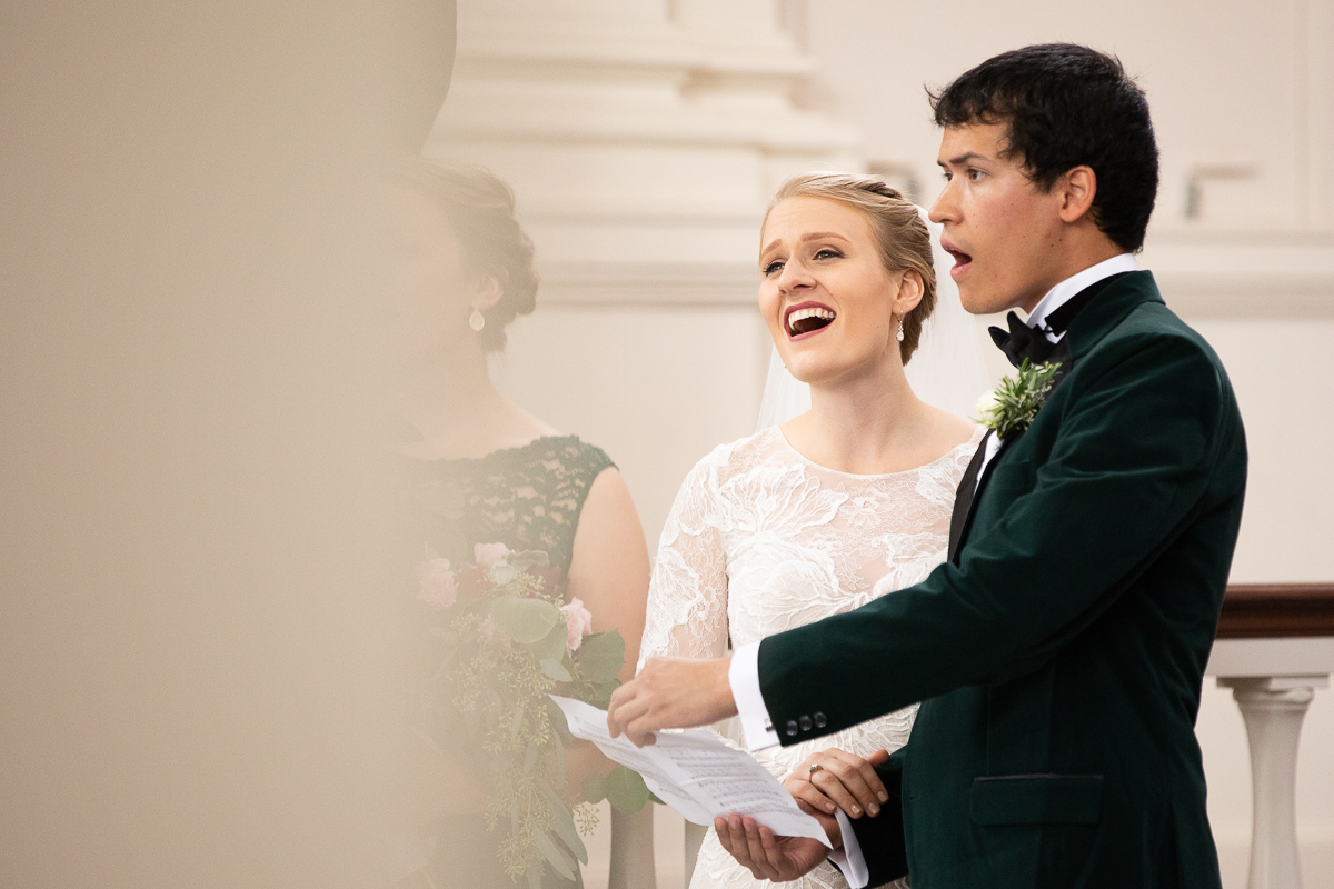 Bride and groom singing during wedding ceremony.