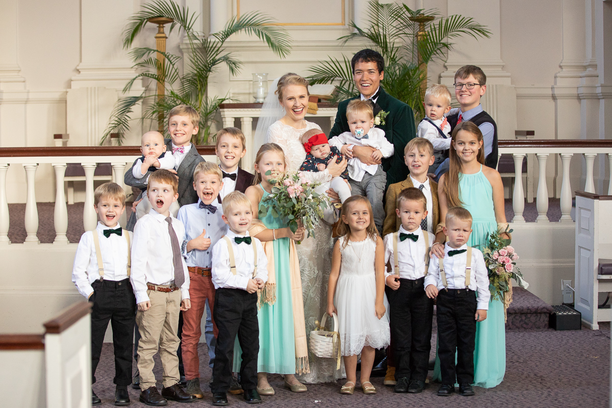Bride and groom with nieces and nephews.
