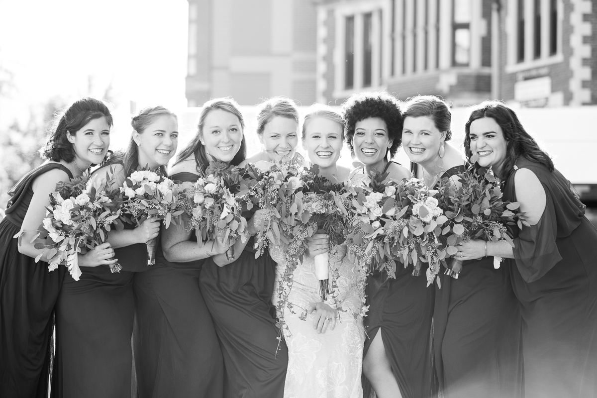 Bride and bridesmaids laughing in Boston wedding.