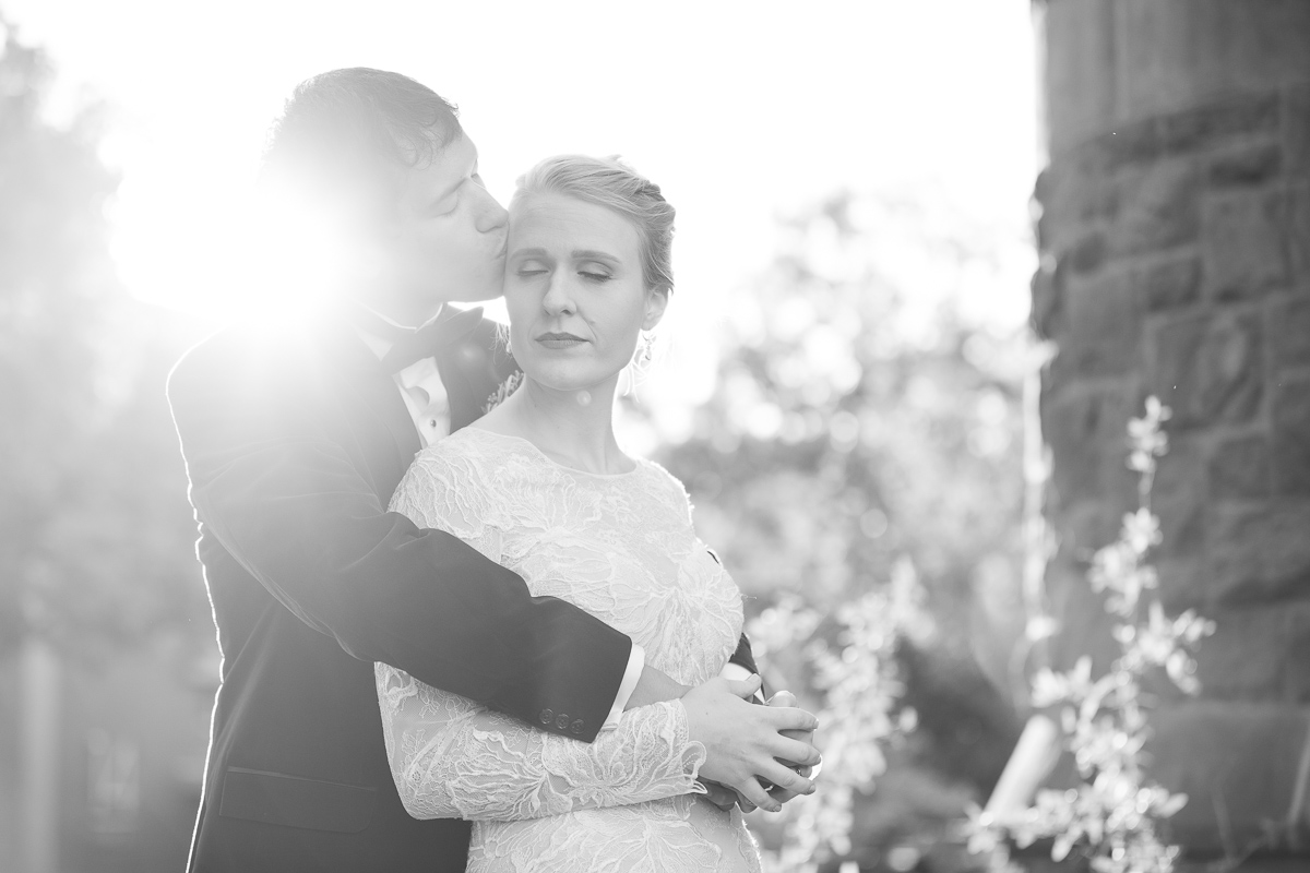 Black and white photo of bride and groom in Boston at golden hour.
