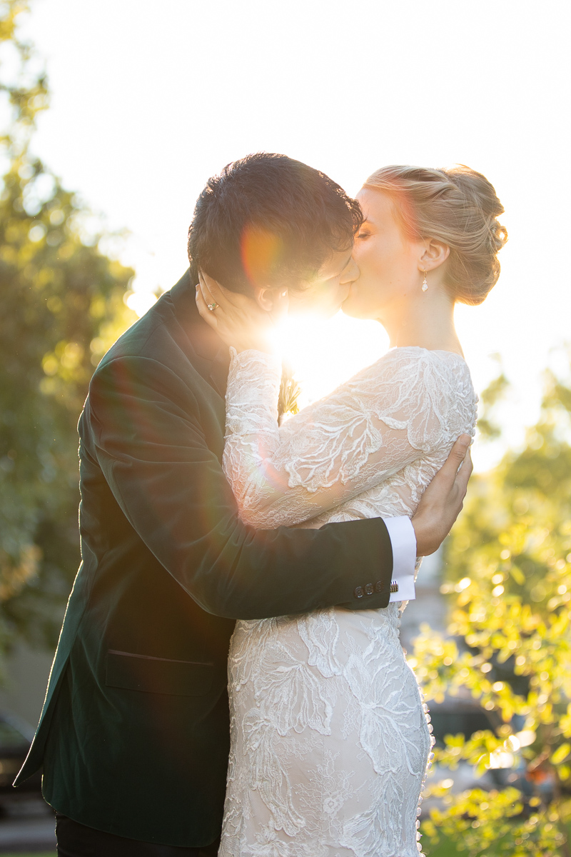 Bride and groom kissing at golden hour in Boston wedding.